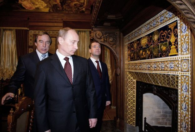 2009 picture Dmitry Medvedev (R) and PM Vladimir Putin (front), St Petersburg House of Music's artistic director Sergei Roldugin