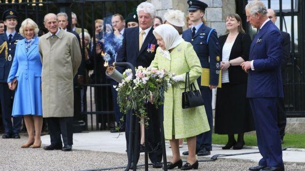 The Queen lighting a beacon
