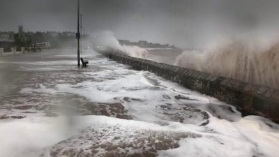 Storm Callum: Flood defences fail and homes without power - BBC News