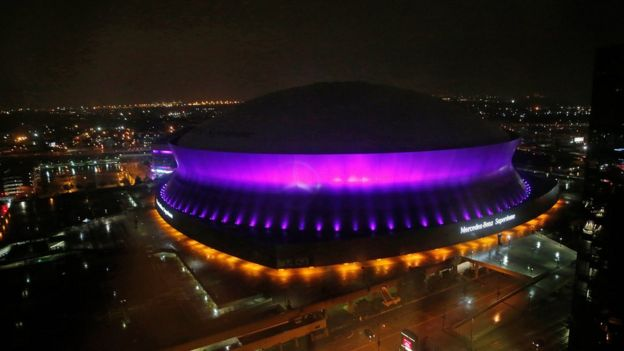 The Mercedes-Benz Superdome is lit up in the color purple in New Orleans, 21 April 2016, to honour Prince