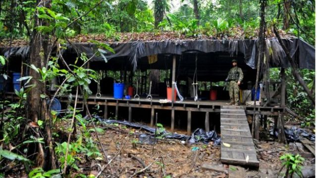 A Colombian soldier stands guard inside a cocaine laboratory in the forest area of Buenaventura, Valle del Cauca department, Colombia, on March 17 2010.