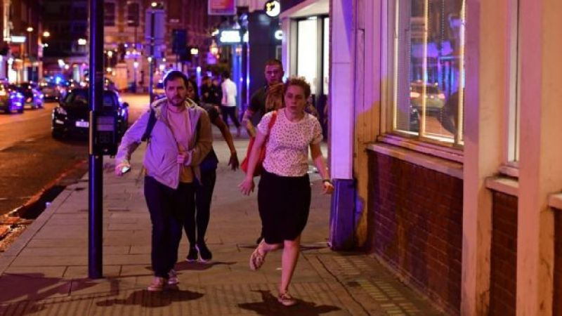 People run down Borough High Street as police are dealing with a