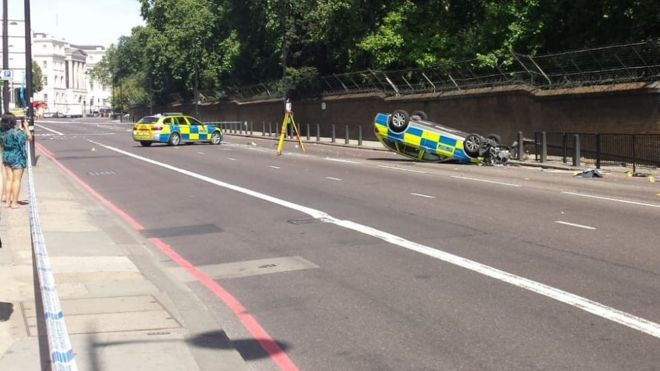 Met Police car overturns in London moped chase   BBC News overturned police car