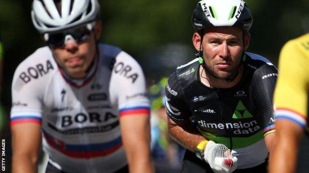 Mark Cavendish makes his way slowly over the line at the end of stage four