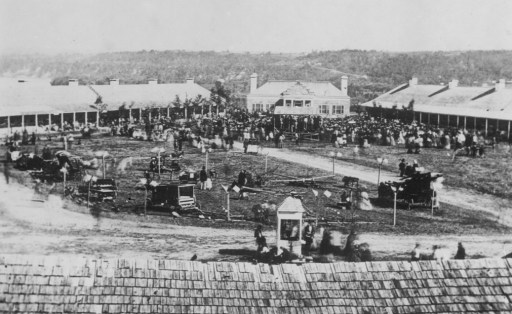 1860: THE FIRST MINNESOTA STATE FAIR HELD AT FORT SNELLINGTaken looking across the parade grounds towards the commandant's house. Most of the people are grouped at the far end around some sort of a stand, Well is visible at front center. Broad expanse of the river valley is also visible. (Steve: in 1860, my great-great grandparents had just settled in after emigrating from Germany and the State Fair is nearly upon us)