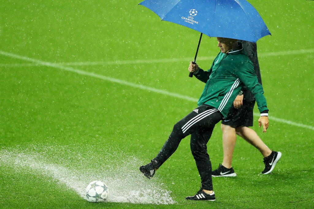 MANCHESTER, ENGLAND - SEPTEMBER 13:  Referee Bjorn Kuipers assesses the waterlogged pitch prior to the UEFA Champions League Group A match between Manchester City FC and VfL Borussia Moenchengladbach at Etihad Stadium on September 13, 2016 in Manchester, England.  (Photo by Richard Heathcote/Getty Images)
