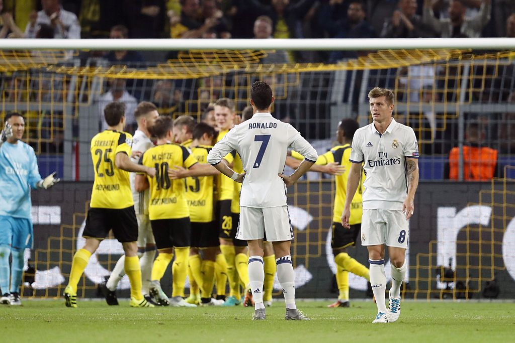 (L-R) goalkeeper Keylor Navas of Real Madrid, Sokratis Papastathopoulos of Borussia Dortmund, Sergio Ramos of Real Madrid, Mario Gotze of Borussia Dortmund, Raphael Guerreiro of Borussia Dortmund, Pierre-Emerick Aubameyang of Borussia Dortmund, Matthias Ginter of Borussia Dortmund, Cristiano Ronaldo of Real Madrid, Ousmane Dembele of Borussia Dortmund, Toni Kroos of Real Madrid during the UEFA Champions League group F match between Borussia Dortmund and Real Madrid on September 27, 2016 at the Signal Iduna Park stadium in Dortmund, Germany.(Photo by VI Images via Getty Images)