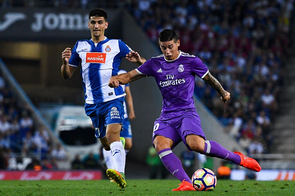BARCELONA, SPAIN - SEPTEMBER 18:  James Rodriguez of Real Madrid CF scores his team's first goal under a challenge by Gerard Moreno of RCD Espanyol during the La Liga match between RCD Espanyol and Real Madrid CF at the RCDE stadium on September 18, 2016 in Barcelona, Spain.  (Photo by David Ramos/Getty Images)