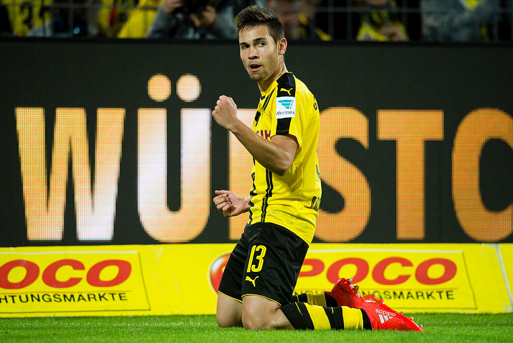 DORTMUND, GERMANY - SEPTEMBER 23: Raphael Guerreiro of Borussia Dortmund celebrates after scoring the goal to the 3:1 during the Bundesliga match between Borussia Dortmund and SC Freiburg at Signal Iduna Park on September 23, 2016 in Dortmund, Germany.  (Photo by Alexandre Simoes/Borussia Dortmund/Getty Images)