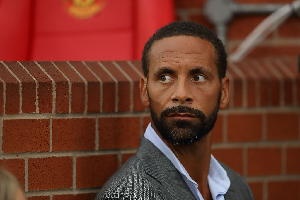 MANCHESTER, ENGLAND - AUGUST 03: Former Manchester United player Rio Ferdinand working for TV Broadcaster BT Sport during the Wayne Rooney Testimonial match between Manchester United and Everton at Old Trafford on August 3, 2016 in Manchester, England. (Photo by Matthew Ashton - AMA/Getty Images)