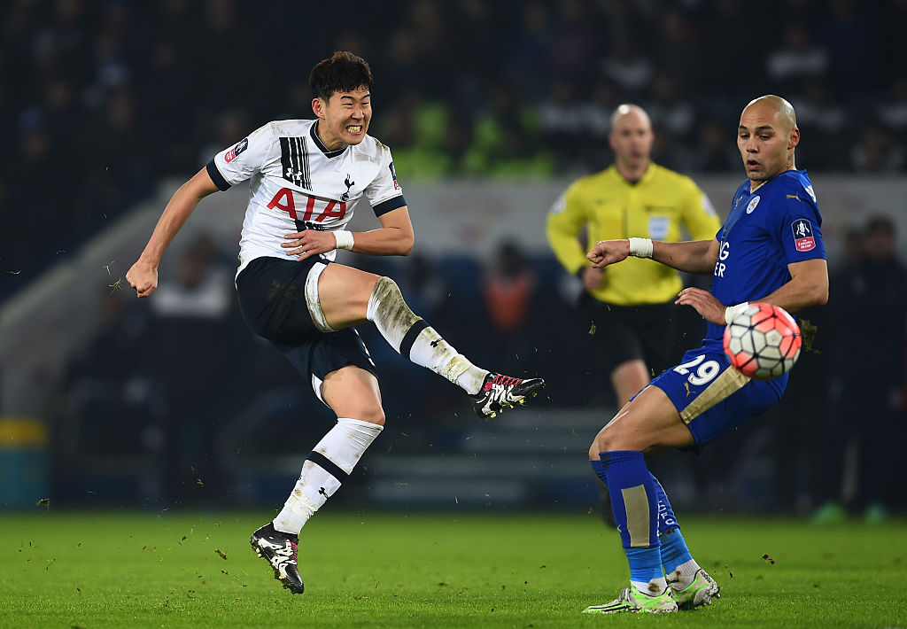 LEICESTER, ENGLAND - JANUARY 20: Son Heung-Min of Spurs takes a shot on goal past Yohan Benalouane of Leicester City during the Emirates FA Cup Third Round Replay match between Leicester City and Tottenham Hotspur at The King Power Stadium on January 20, 2016 in Leicester, England. (Photo by Laurence Griffiths/Getty Images)