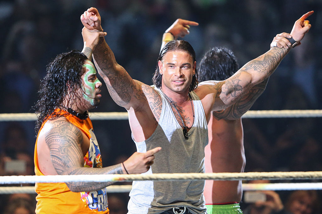 FRANKFURT AM MAIN, GERMANY - NOVEMBER 15:  Tim Wiese celebrates with The Usos during WWE Live 2014 at Festhalle on November 15, 2014 in Frankfurt am Main, Germany.  (Photo by Simon Hofmann/Bongarts/Getty Images)