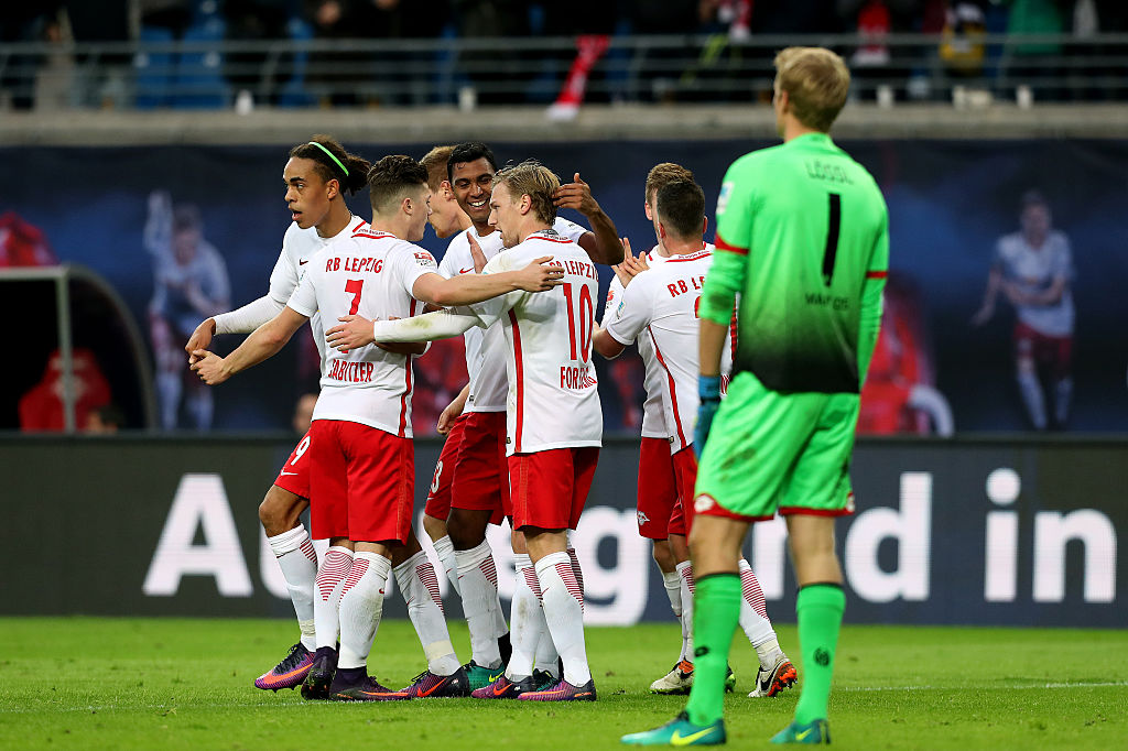 LEIPZIG, GERMANY - NOVEMBER 06: Players of Leipzig celebrate after scoring their team's third goal during the Bundesliga match between RB Leipzig and 1. FSV Mainz 05 at Red Bull Arena on November 6, 2016 in Leipzig, Germany. (Photo by Ronny Hartmann/Bongarts/Getty Images)