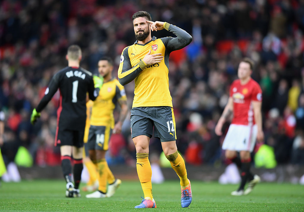 MANCHESTER, ENGLAND - NOVEMBER 19: Olivier Giroud of Arsenal celebrates scoring his sides first goal  during the Premier League match between Manchester United and Arsenal at Old Trafford on November 19, 2016 in Manchester, England.  (Photo by Michael Regan/Getty Images)