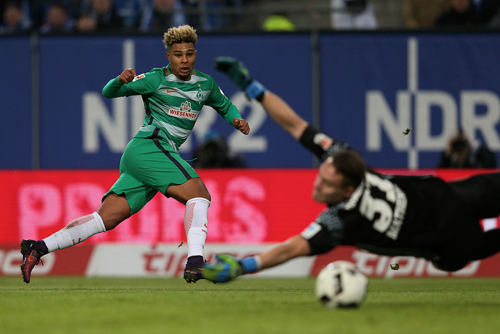x of Hamburg and x of Bremen compete for the ball during the Bundesliga match between Hamburger SV and Werder Bremen at Volksparkstadion on November 26, 2016 in Hamburg, Germany.