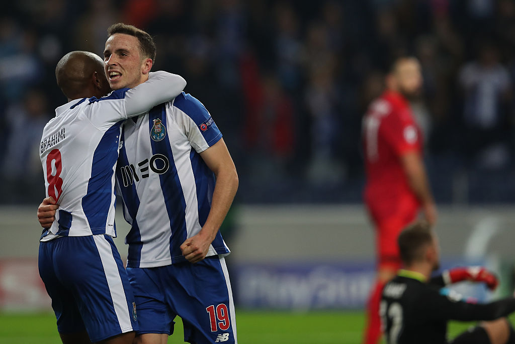 PORTO, PORTUGAL - DECEMBER 07: FC Porto's forward Diogo Jota from Portugal (R) celebrates scoring Porto fifth goal with FC Porto's forward Yacine Brahimi from Algeria (L) during the match between FC Porto v Leicester City FC - UEFA Champions League match at Estadio do Dragao on December 07, 2016 in Porto, Portugal.  (Photo by Carlos Rodrigues/Getty Images)