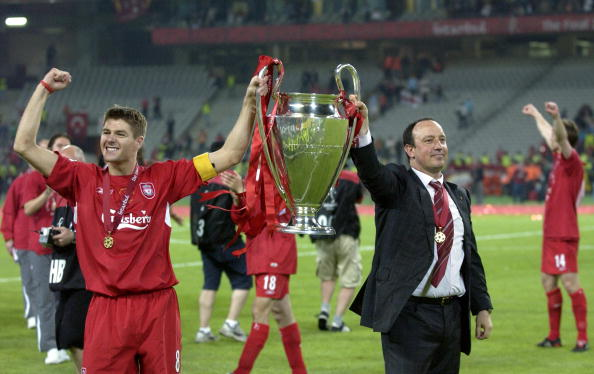 BT Sport, Football, UEFA Champions League Final, 25th May 2005, Ataturk Stadium, Istanbul, AC Milan 3 v Liverpool 3, ( Liverpool won 3-2 on penalties), Liverpool captain Steven Gerrard (left) with manager Rafael Benitez celebrate with the trophy