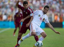 CARACAS, VENEZUELA - JUNE 07:  Sergio Busquets (#16) from Spain fights for the ball with  Tomas Rincón (#8) from Venezuela during a friendly match between Venezuela and Spain at Jose Antonio Anzoategui Stadium on June 07, 2011 in Puerto La Cruz, Venezuela. (Photo by Nelson Pulido/ LatinContent/Getty Images)