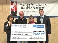 Larry Miller Tom Scott Donation