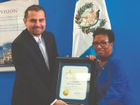 IECN Staff Photo   Consul General Billy Munoz (left) receiving a certificate of recognition from Assemblywoman Cheryl Brown (D-San Bernardino).