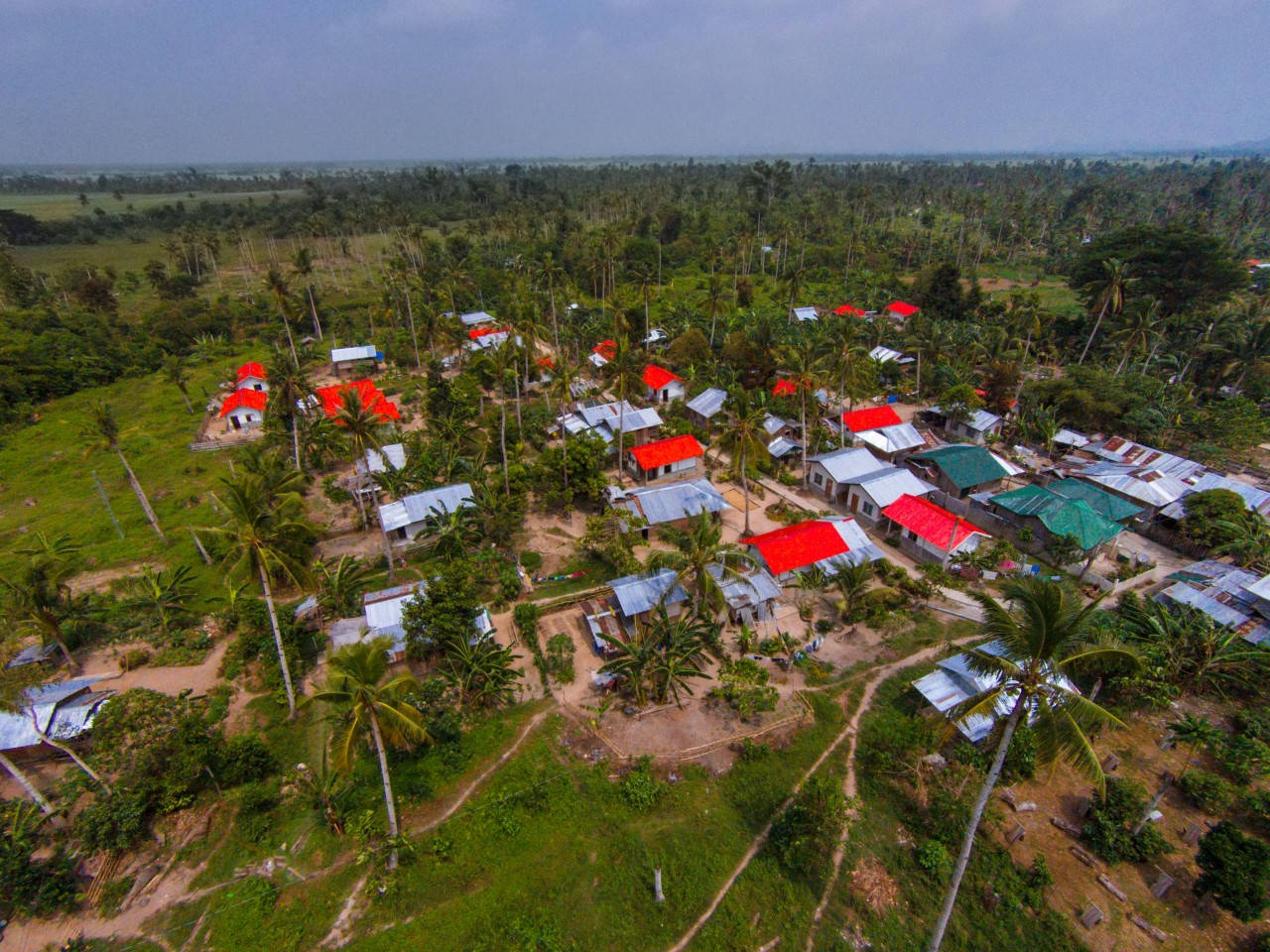 Dagami, Leyte, 2015. Aerial view of Red Cross Red Roof Shelter in Brgy. Balilit, Dagami in Leyte. Rommel Cabrera / IFRC.