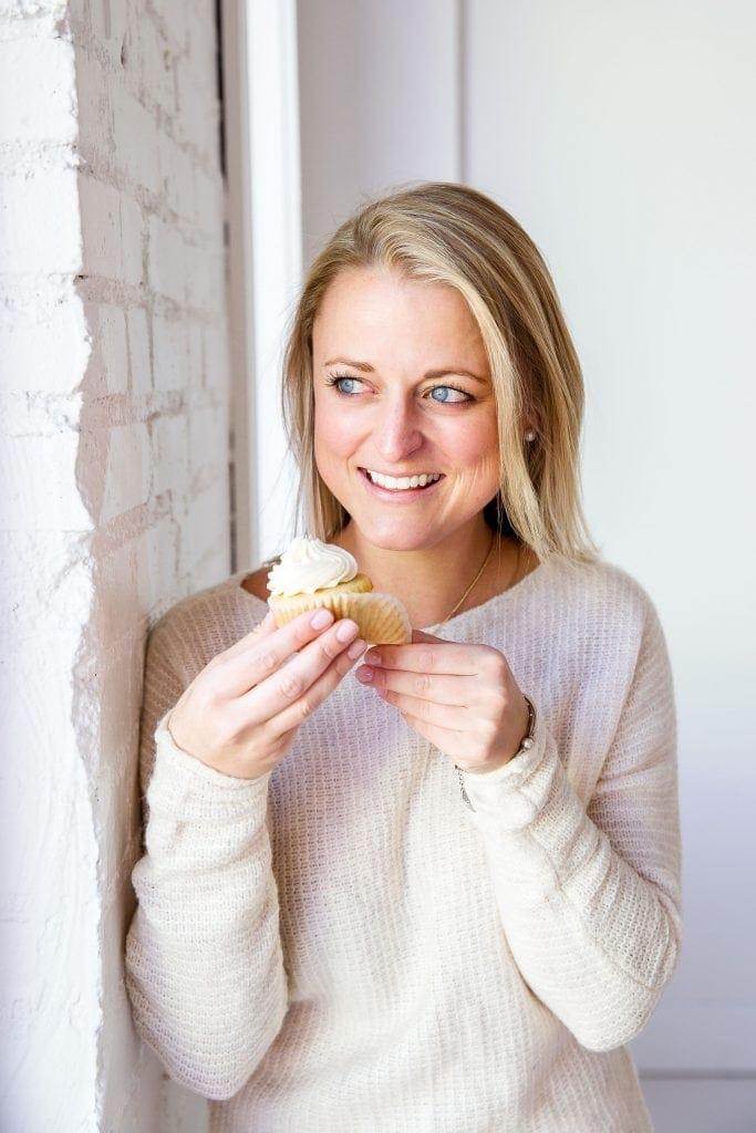 haley blonde baker holding cupcake