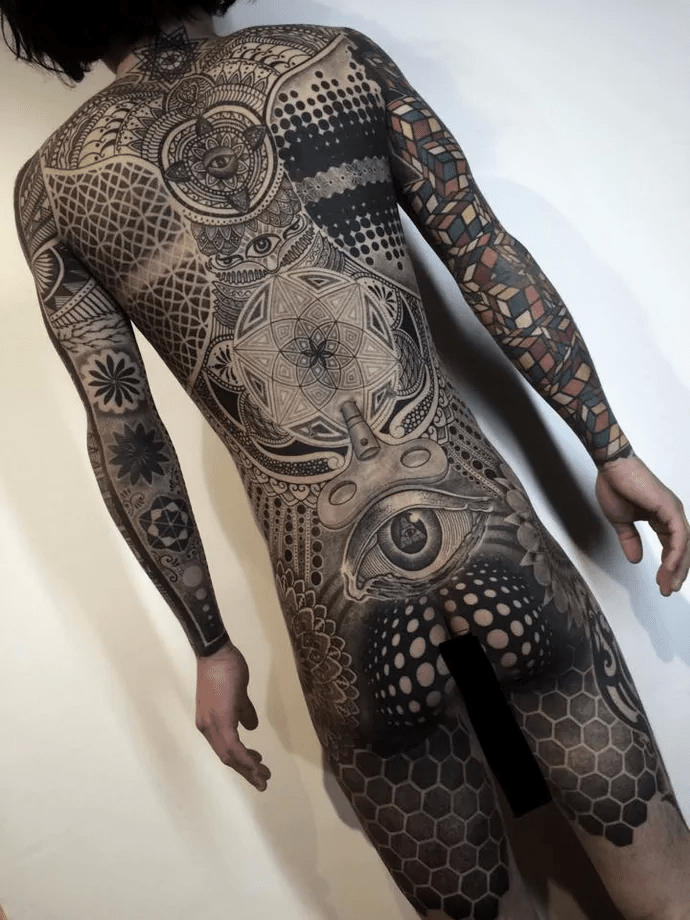 Tattoo artist Nissaco almost broke the internet with his out of this world geometric bodysuit
