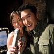 Couple singing karaoke