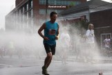 Runners cool off during a hot Peachtree Road Race in Atlanta