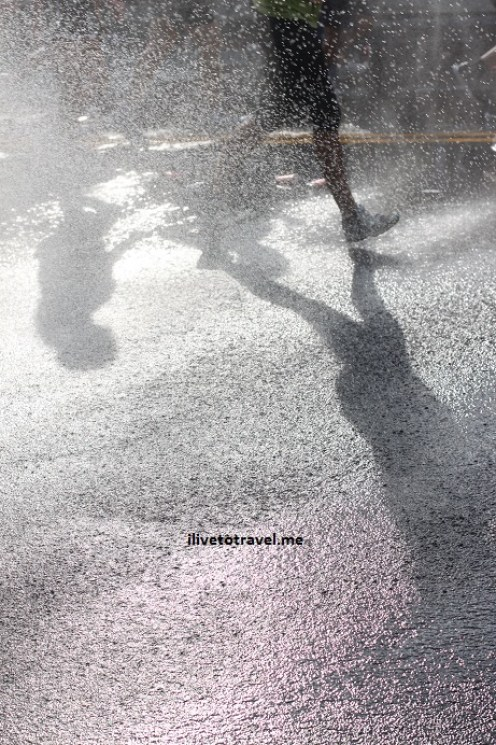 Runner's shadow on the pavement at the Peachtree Road Race in Atlanta