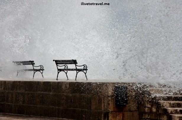 Waves crashing in Dubrovnik's sea walkway 2