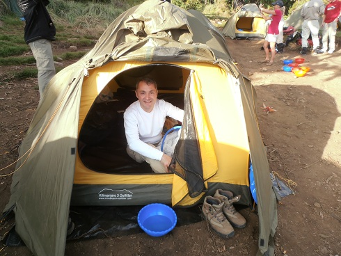 Trekker at camp in Kilimanjaro