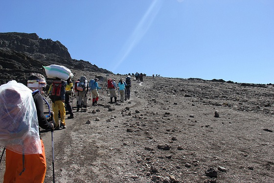 Day 5 Headed to Barafu Camp on the Machame Route over rocky terrain in Mt. Kilimanjaro