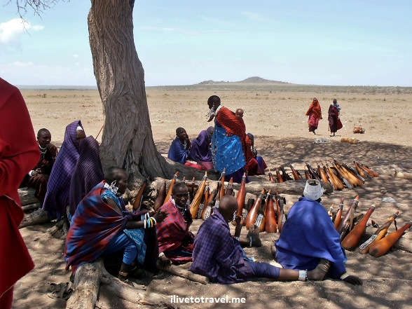 Masai women with the containers to store cow's milk and blood