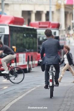 man on a bike, red bud, cellphone, Stockholm, Sweden, summer, street scene, travel, photo, Canon EOS Rebel
