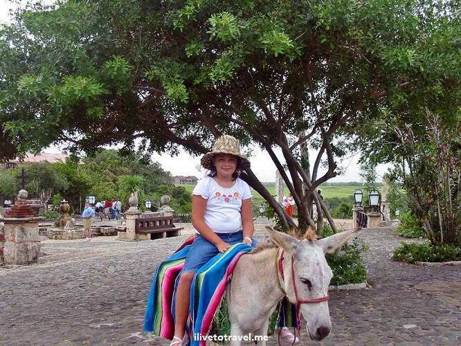 Altos de Chavon, La Romana, Dominican Republic, girl on a burro