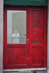 Rome, red door, cloudspark, glass reflection
