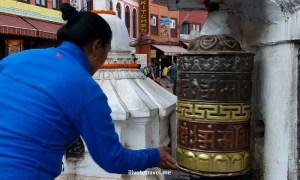 Turning the wheel while saying the prayer