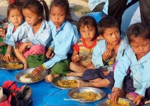 Kids enjoying an early dinner