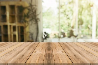 Wooden board empty table in front of blurred background. Perspective brown wood over blur in ...
