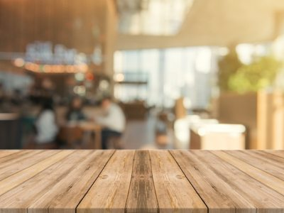 Wooden board empty table top on of blurred background. Photo | Free Download