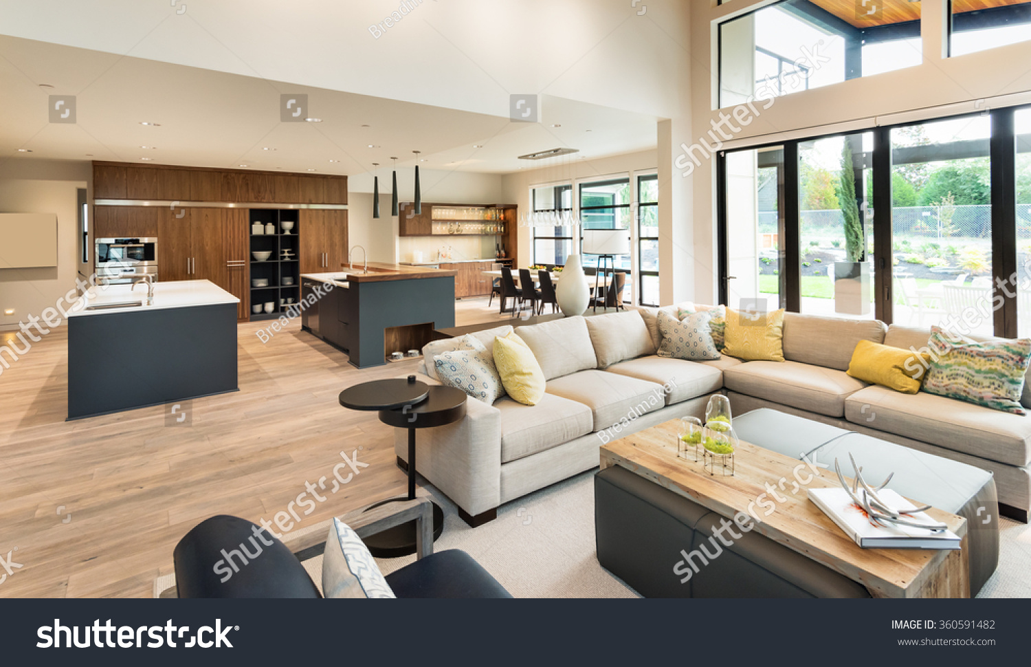 stock photo beautiful living room interior in new luxury home with view of kitchen home interior with hardwood 360591482