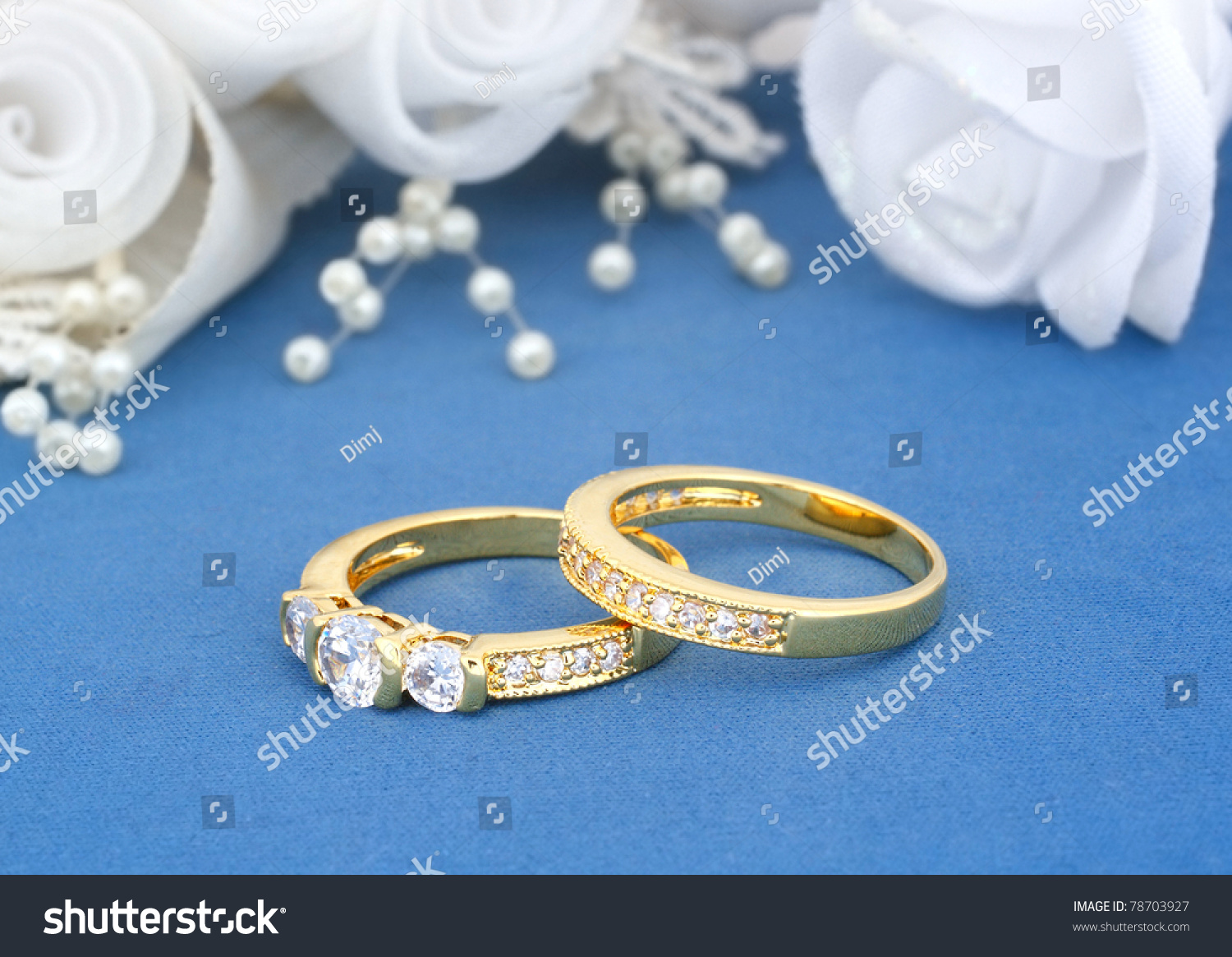 stock photo wedding rings on blue with flowers background blue wedding rings wedding rings on blue with flowers background