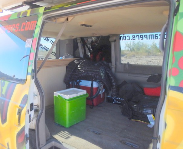 With the back seat out, it's very large and open. Even the coolers came with the van.
