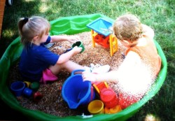 Small Of Two Kids In A Sandbox