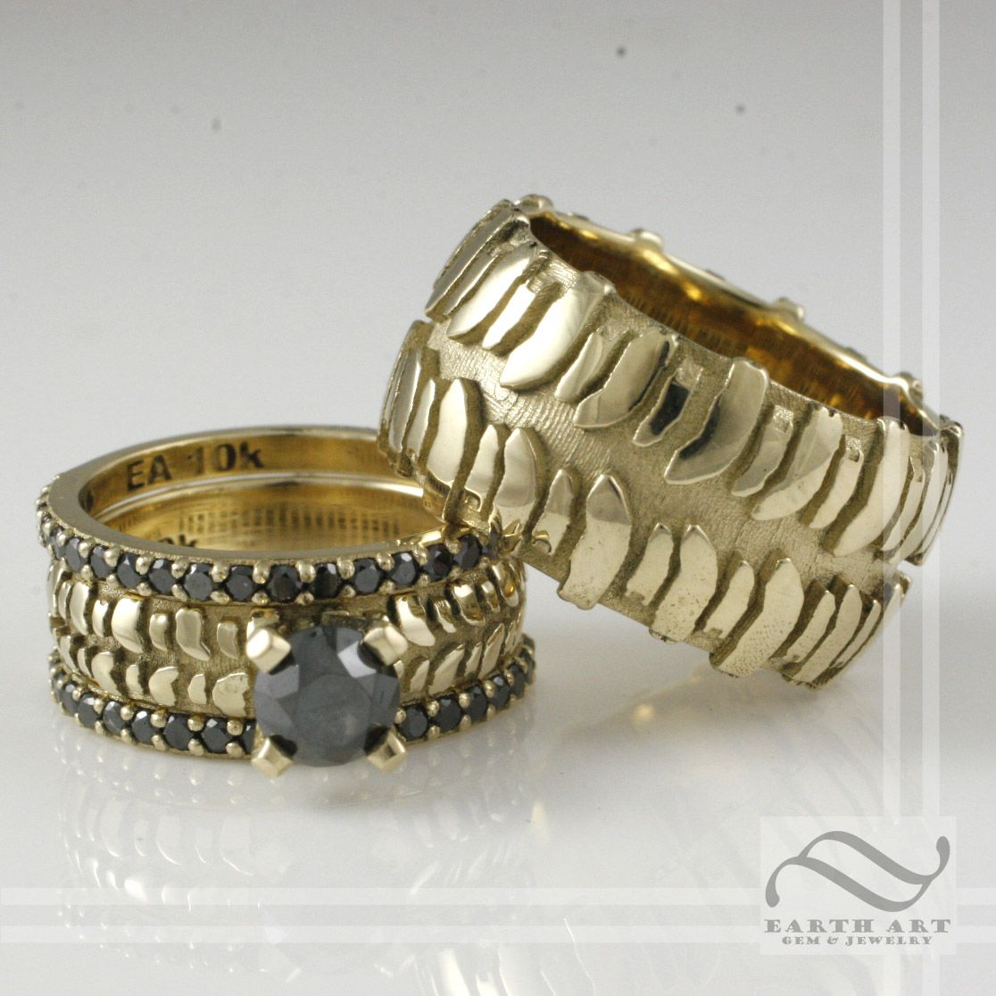 earthartgemandjewelry mud tire wedding rings Tire Tread Set In Gold With Black Diamonds Tire Rings by