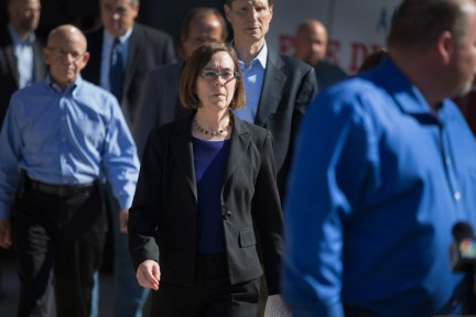 ROSEBURG, OR - OCTOBER 02:  Oregon governor Kate Brown (C) arrives for a press conference where she addressed the mass shooting at Umpqua Community College on October 2, 2015 in Roseburg, Oregon.  Yesterday 26-year-old Chris Harper Mercer went on a shooti