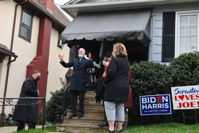 "Democratic presidential candidate Joe Biden(C) visits his childhood home with his granddaughters in Scranton, Pennsylvania on November 3, 2020. - The United States started voting Tuesday in an election amounting to a referendum on Donald Trump's uniquely brash and bruising presidency, which Democratic opponent and frontrunner Joe Biden urged Americans to end to restore ""our democracy."" (Photo by Angela Weiss / AFP) (Photo by ANGELA WEISS/AFP via Getty Images)"