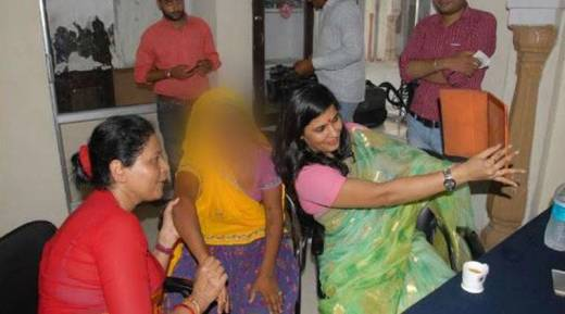 Member of Rajasthan State Commission for Women clicking a selfie with the rape victim/ ANI