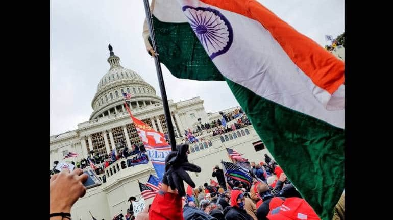 The Indian flag be waived at the US Capitol during the violence on January 6. (Image: Twitter/@VincentPXavier)